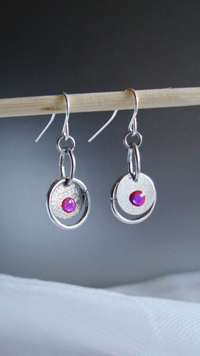 round silver discs with magenta accent