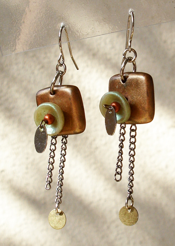 Layered earrings with chains and charms angle