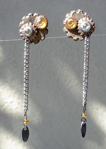 Steampunk posts earrings in sunlight