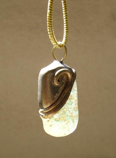aqua and gold pendant left