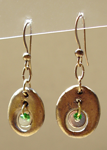 Oval earrings with center charms